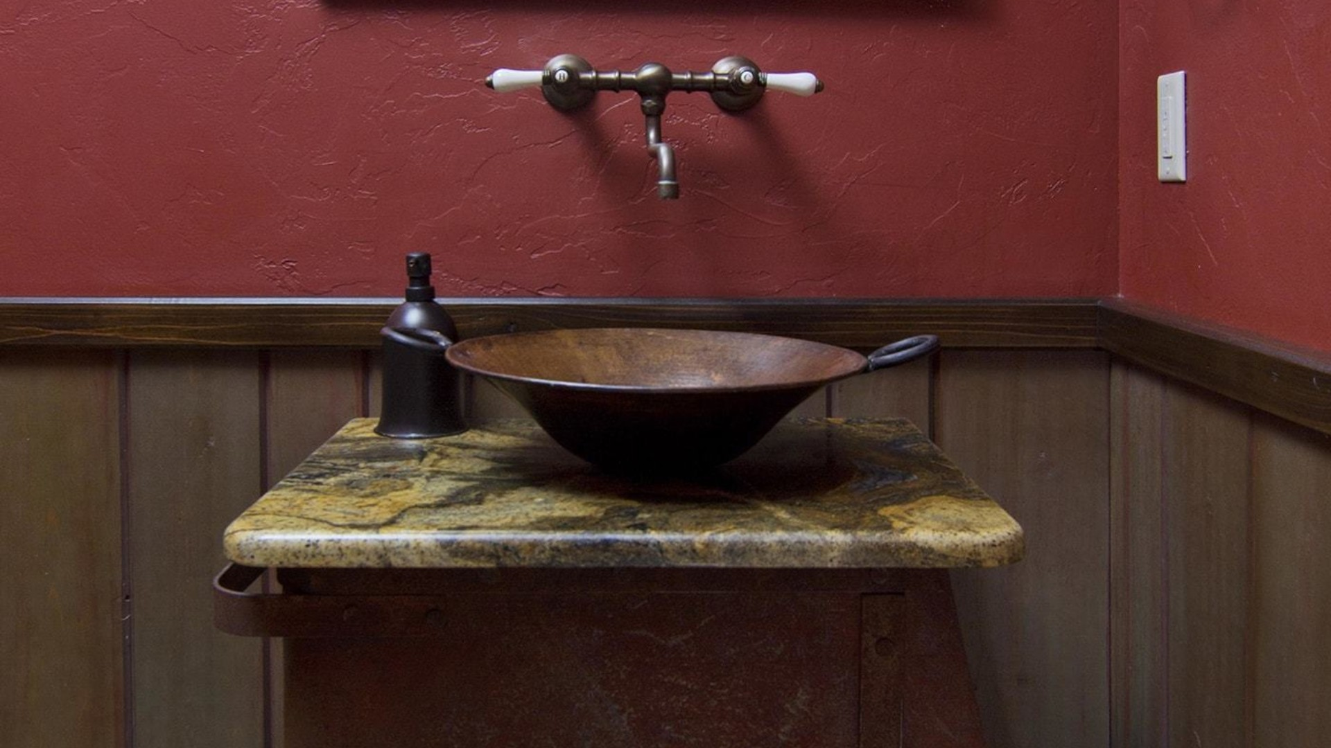 decorative bathroom sink sitting on top of an old mine cart and a piece of track