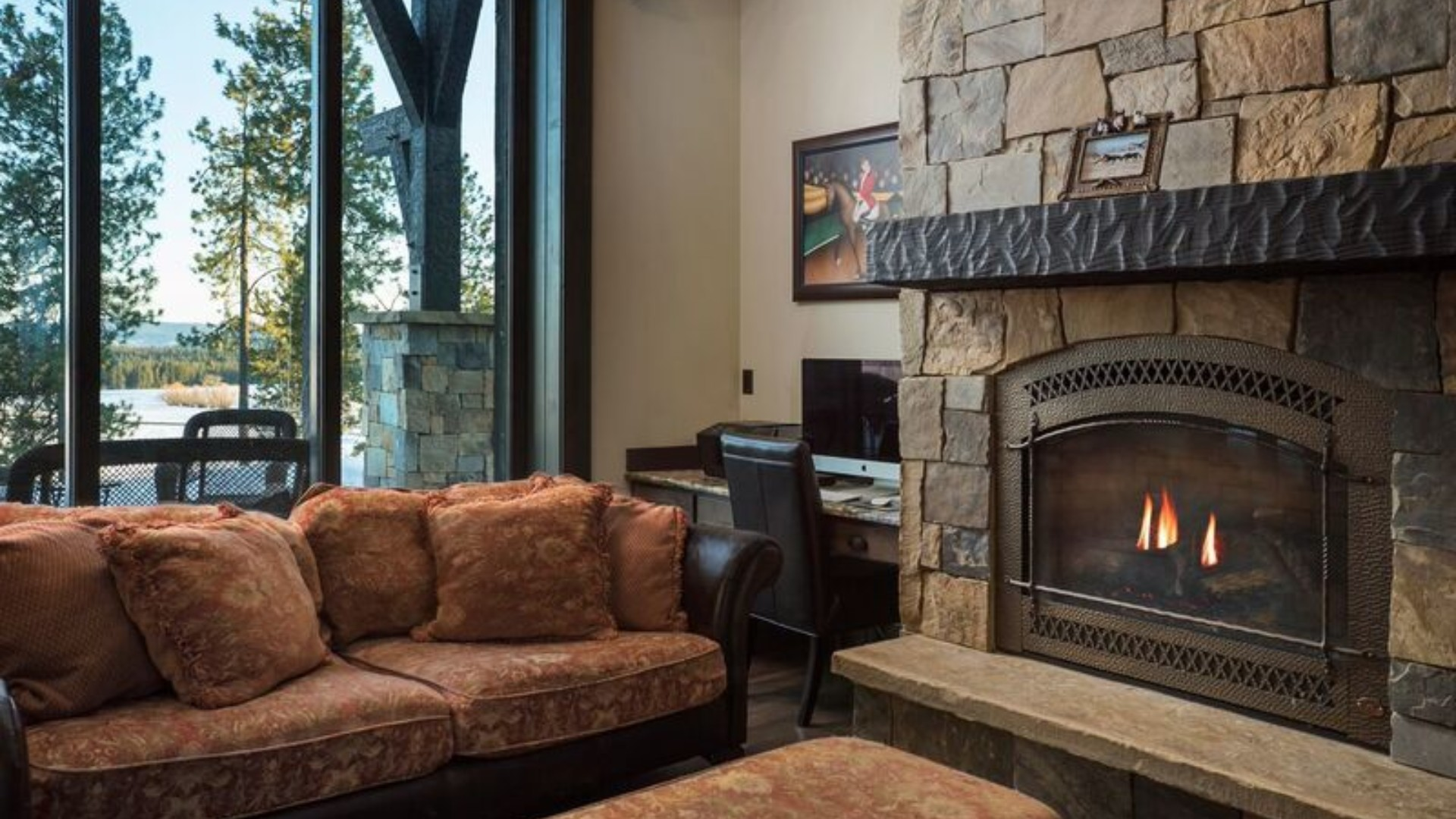 large stone fireplace with a couch