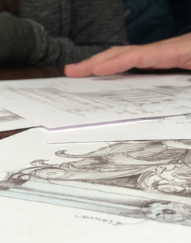 closeup of drafting table and scattered home sketches